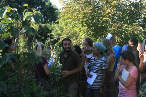 Doug having fun in the food forest tour at Terra Alta