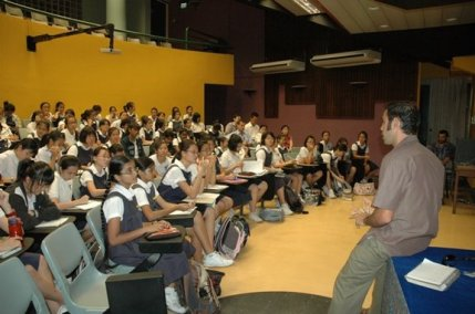 Doug answering questions at Raffles Girls School