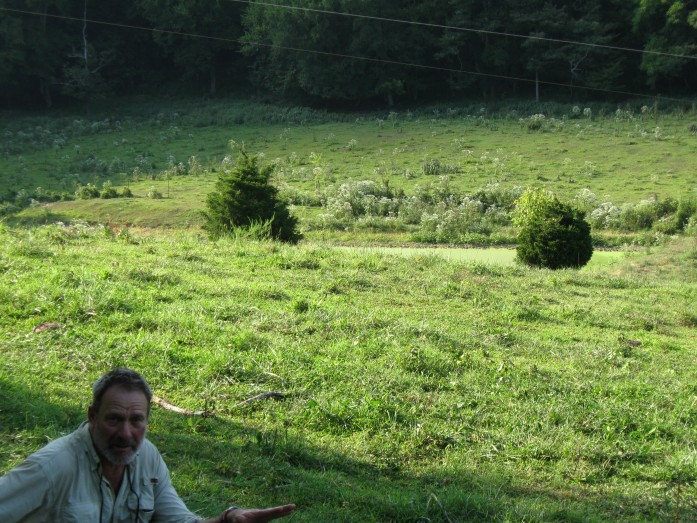 Kirk gadzia surveying a overgrazed pasture