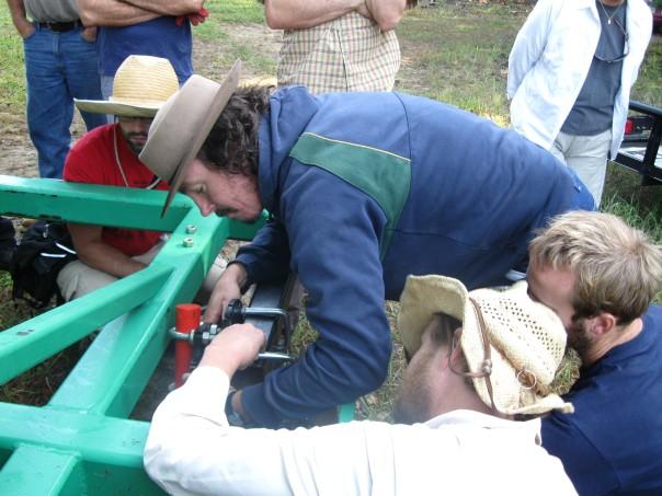Darren Daugherty assembling the plow with Brian Bankston, Christian Shearer and Rob Avis