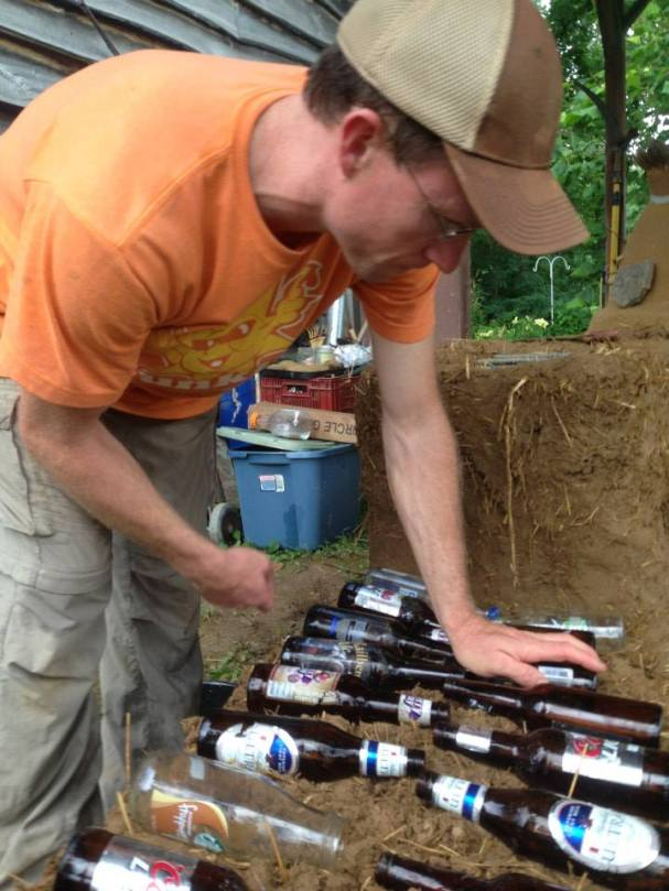 Patrick Sherwin, local Permie and renewables expert, integrating bottles into the bench