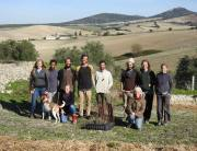 Group photo overlooking the barren hillsides of the surrounding area, the need for diversity is obvious