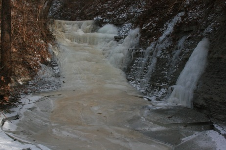 The frozen waterfall with hints of brown, a problem addressed below.