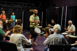 Lawrence leading a drum circle